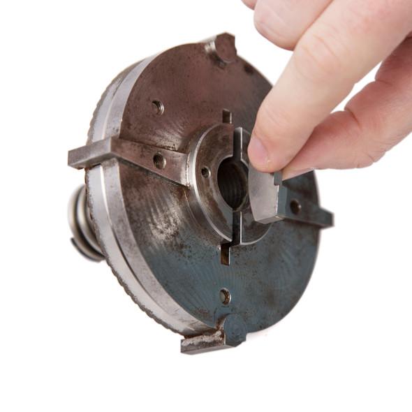 Mahlkonig Stainless Steel Shear Plate for EK43 being inserted into the EK43 Front Burr Mounting Assembly
