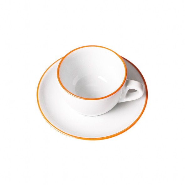 overhead view of orange painted rim cappuccino cup and saucer