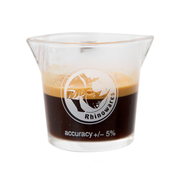 Front view of the Rhino Coffee Gear Double-Spouted Shot Pitcher with espresso inside.
