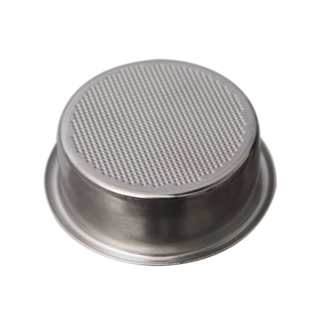 Bottom-view of a Pullman Filtration Basket with a white background.