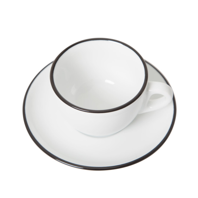 Overhead view of black painted rim cappuccino cup and saucer