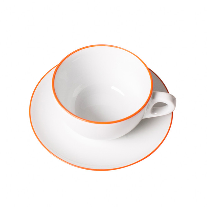 latte cup with orange banding on cup and saucer