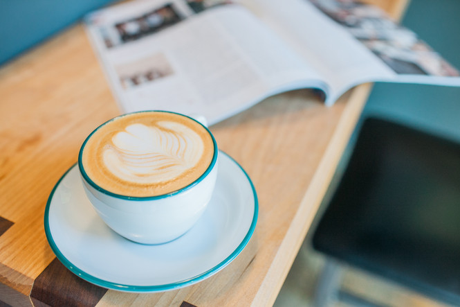 Ancap's cappuccino cup with teal rim