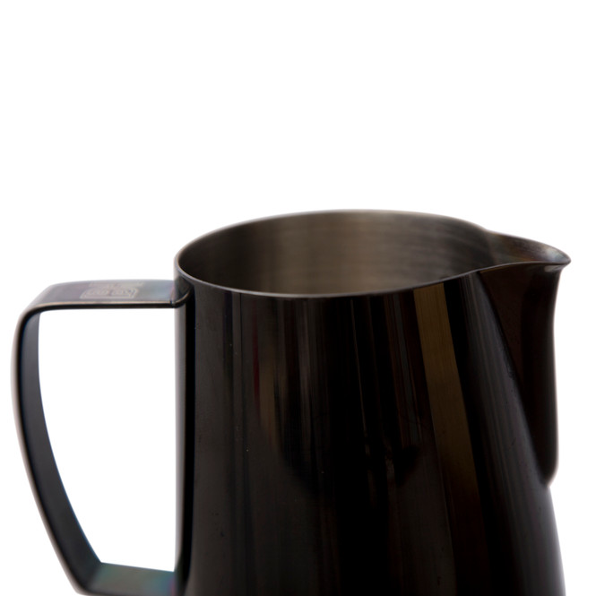 Closeup of the Barista Hustle Precision Milk Pitcher, showing its rolled spout.
