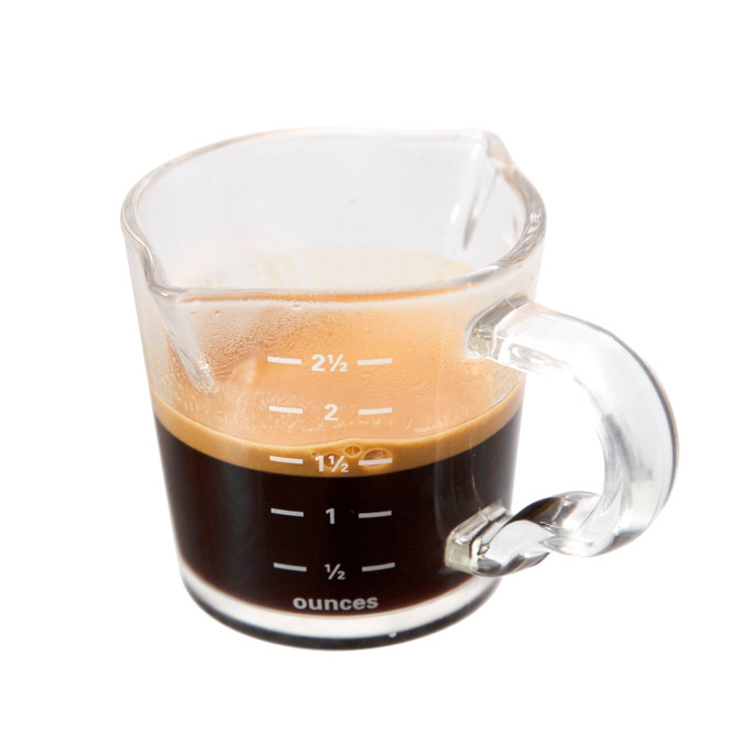 Side view of the Rhino Coffee Gear Double-Spouted Shot Pitcher with espresso inside.