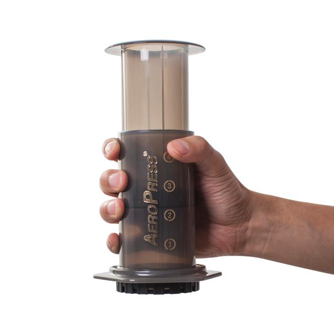 AeroPress Coffee Maker being held