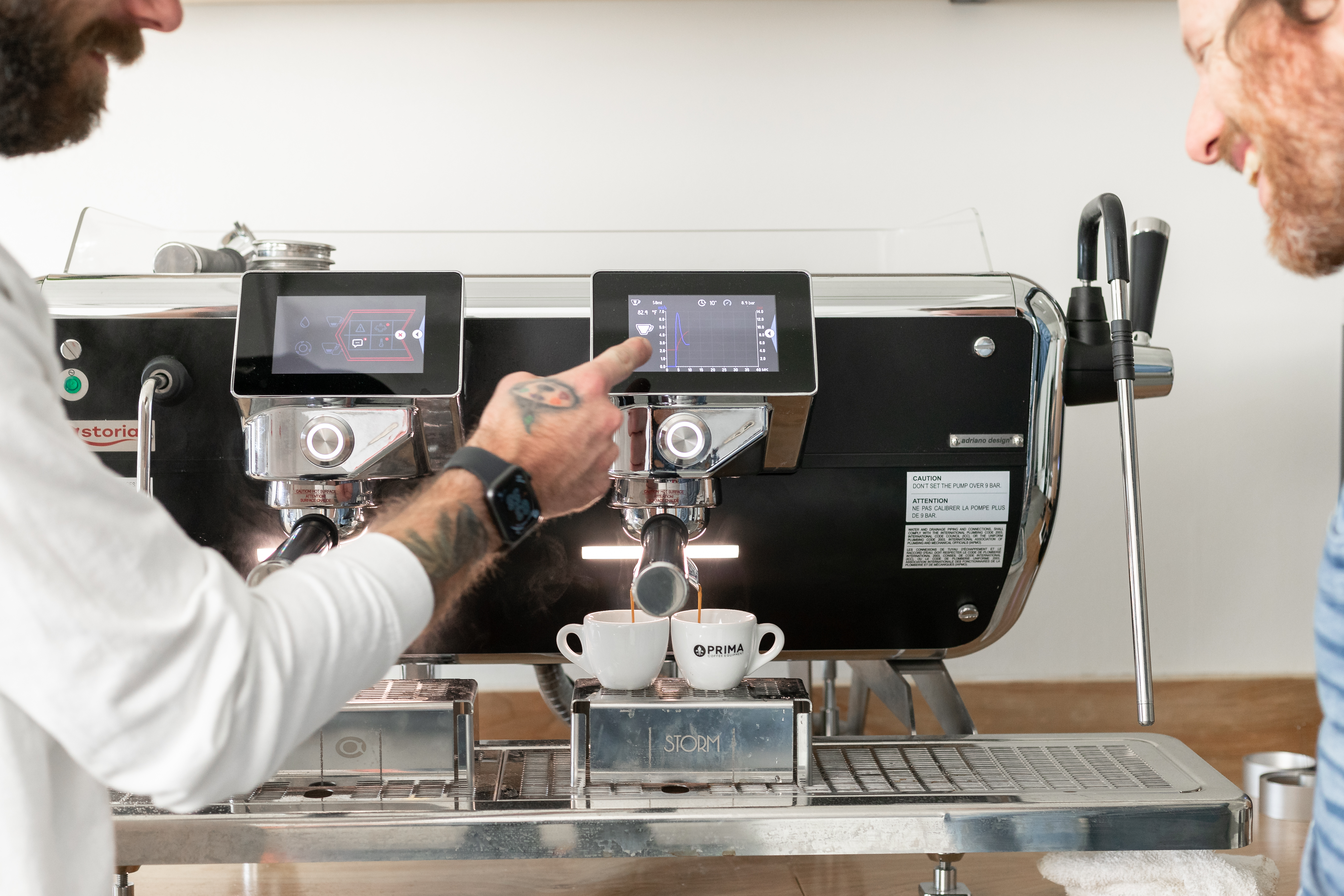 Two men making espresso on the Astoria Tempesta
