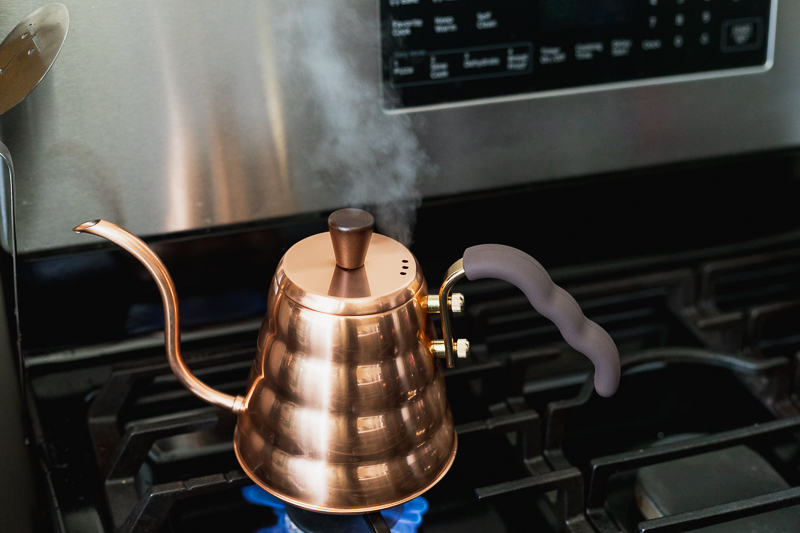 Copper kettle on gas stove