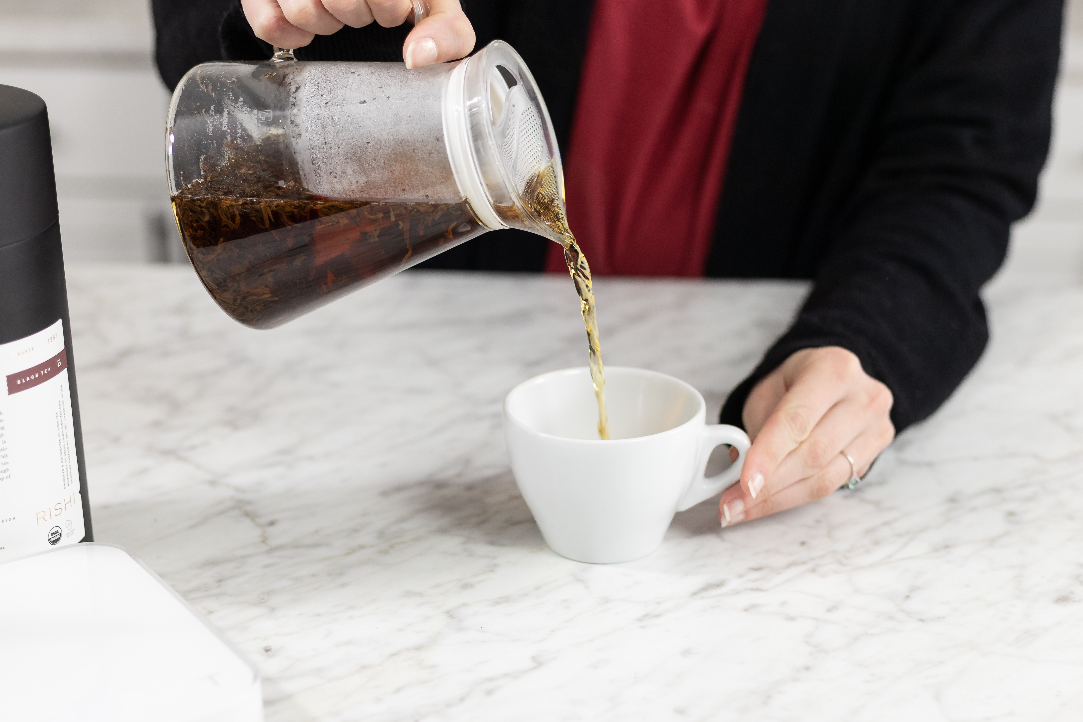 Pouring tea out of Hario Clear Teapot