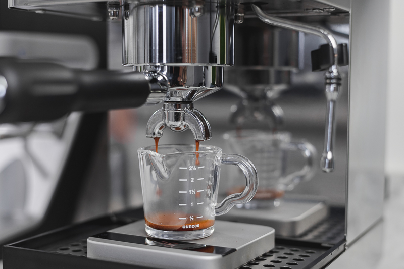 Lelit Anna close up on espresso shot streaming out of double spouted portafilter