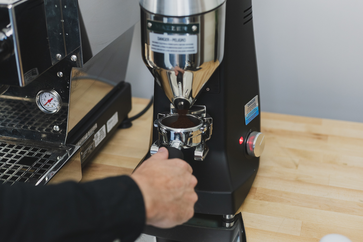View of the Coffee Grinding Into Portafilter