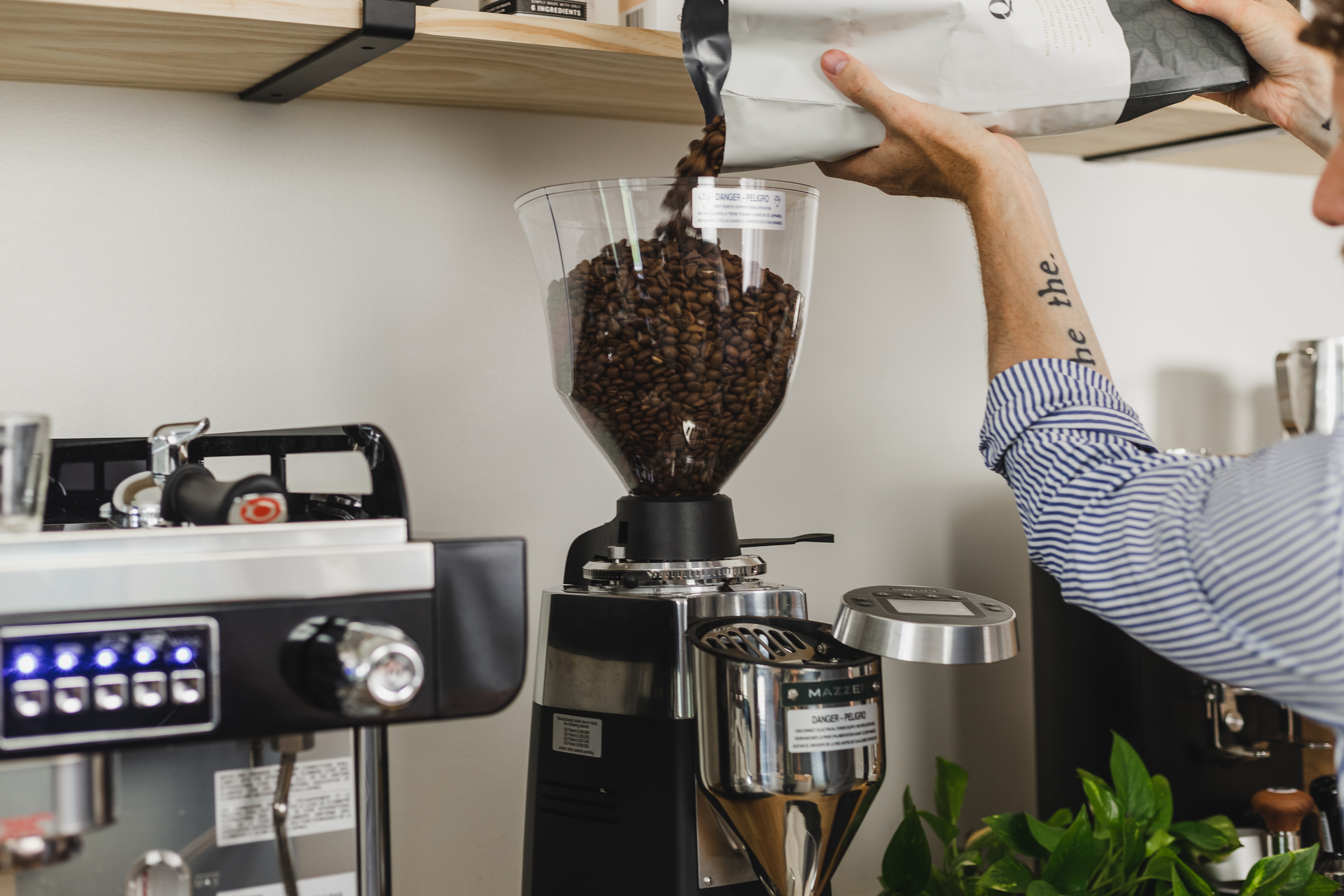 Hopper being filled with coffee beans