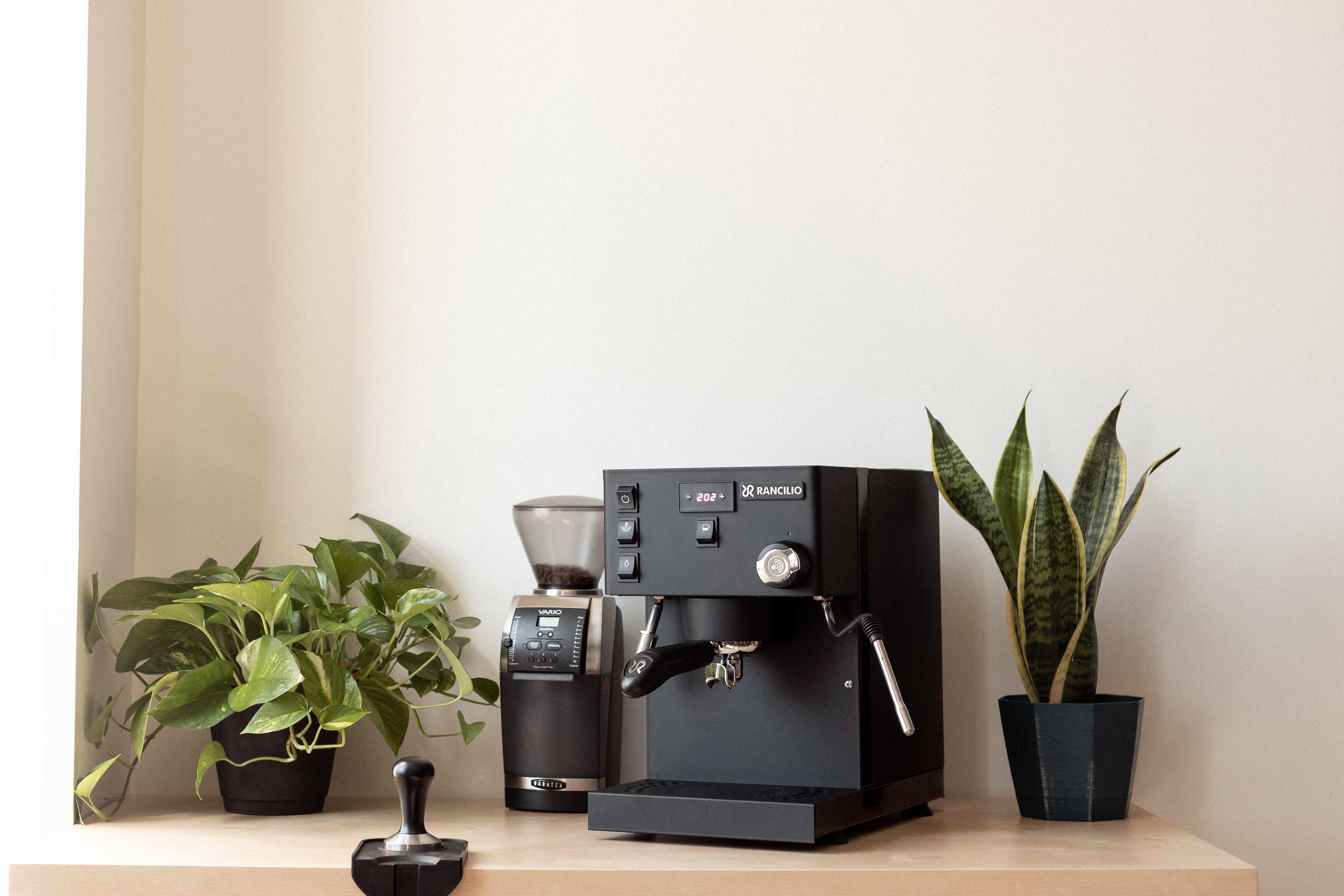 a home espresso setup next to a window