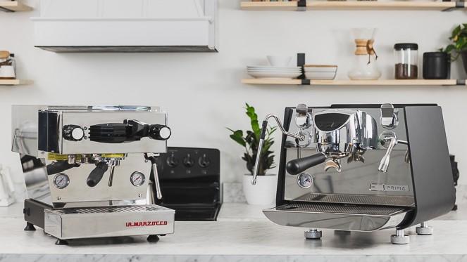 La Marzocco Linea Mini and Victoria Arduino Eagle 1 Prima espresso machines on a counter