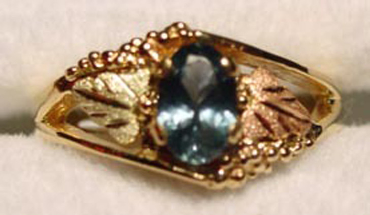 Montana sapphire Black Hills Gold ring leaves on each side.