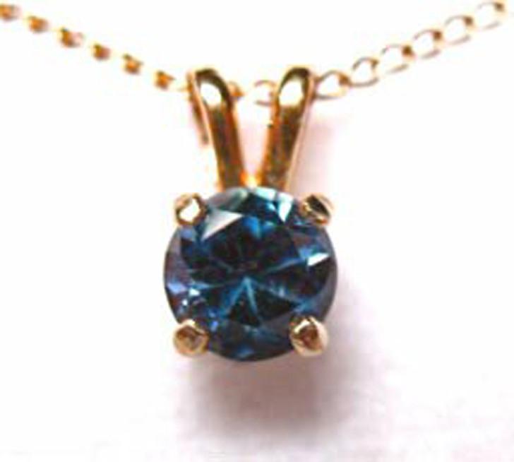 Montana sapphire round pendant in 14K gold.