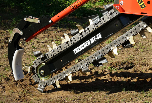 skid steer trencher preparing to start digging a trench.