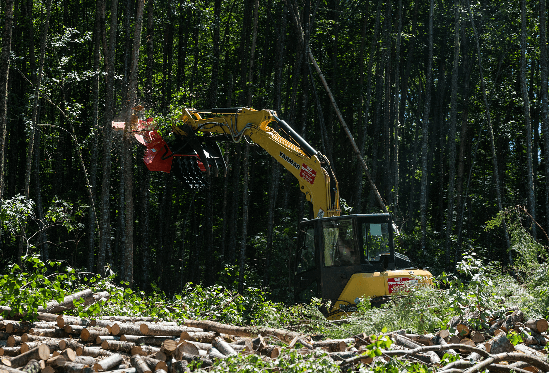 """Cyclone 60"""" excavator rotary brush mower attachment mowing down a tree"""