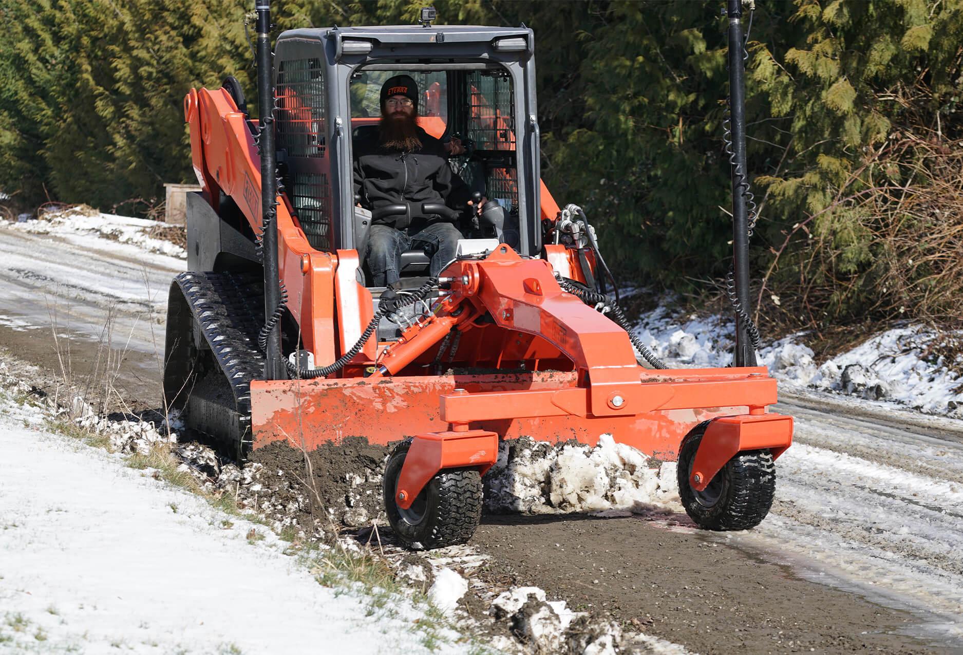 Eterra Dozer Grader Skid Steer Attachment plowing snow