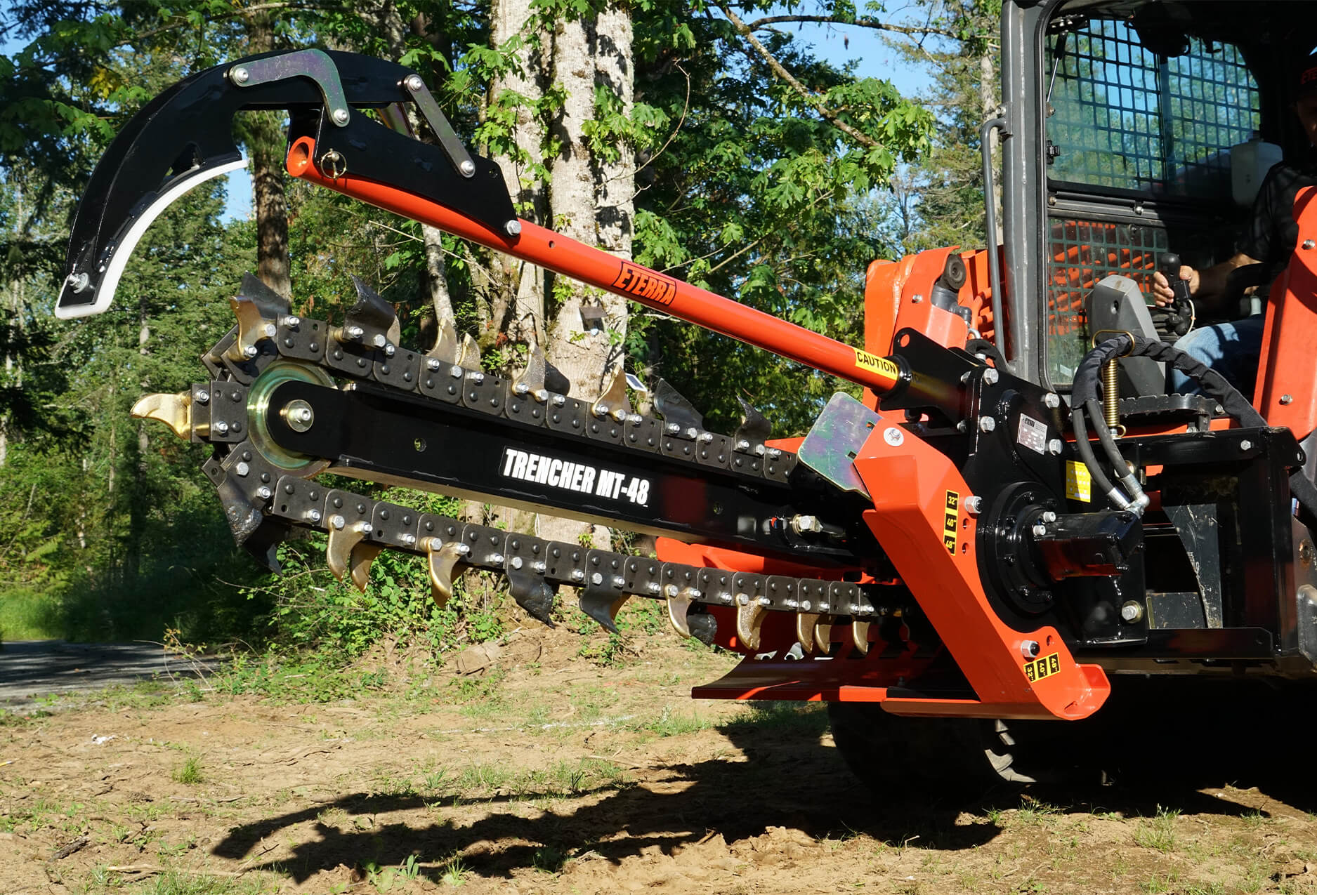 skid steer trencher attachment on a Kubota SVL skid steer loader.