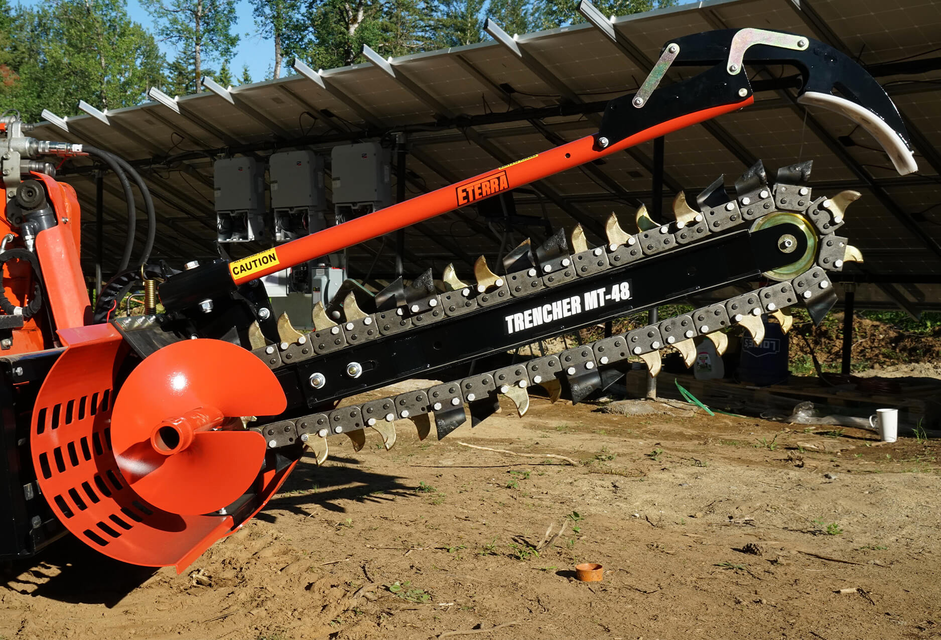 Side angle view of the skid steer trencher attachment.