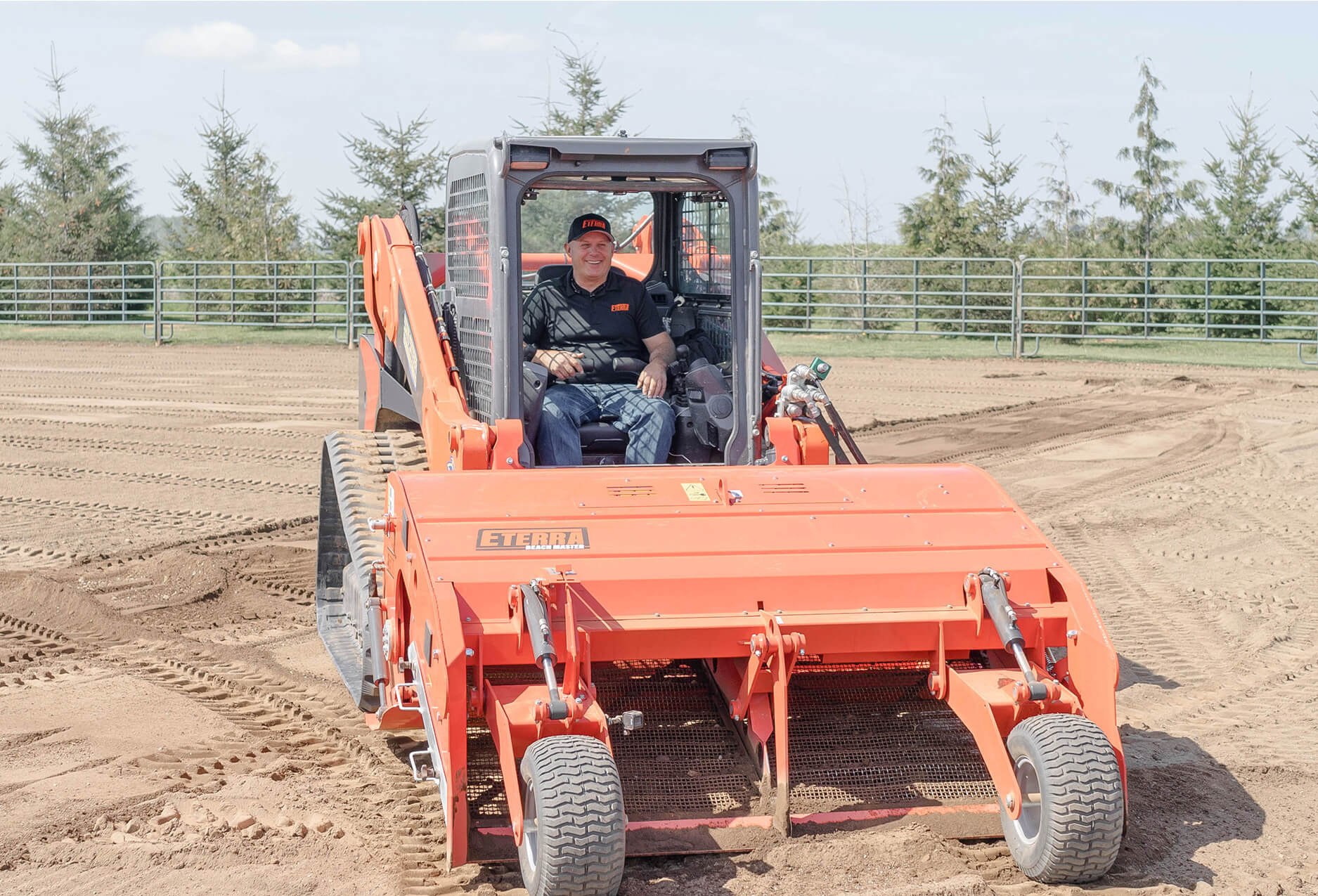 Eterra Beach master skid steer beach and arena cleaner front action