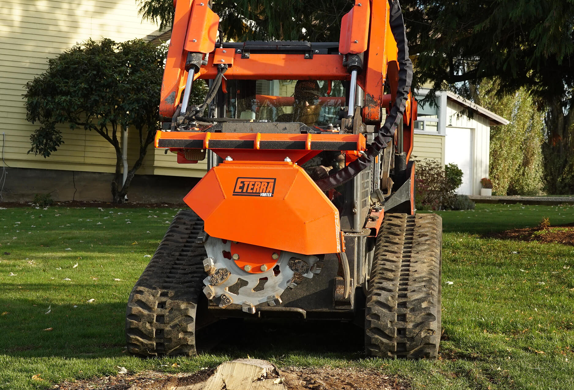 Skid Steer stump grinder demo front view