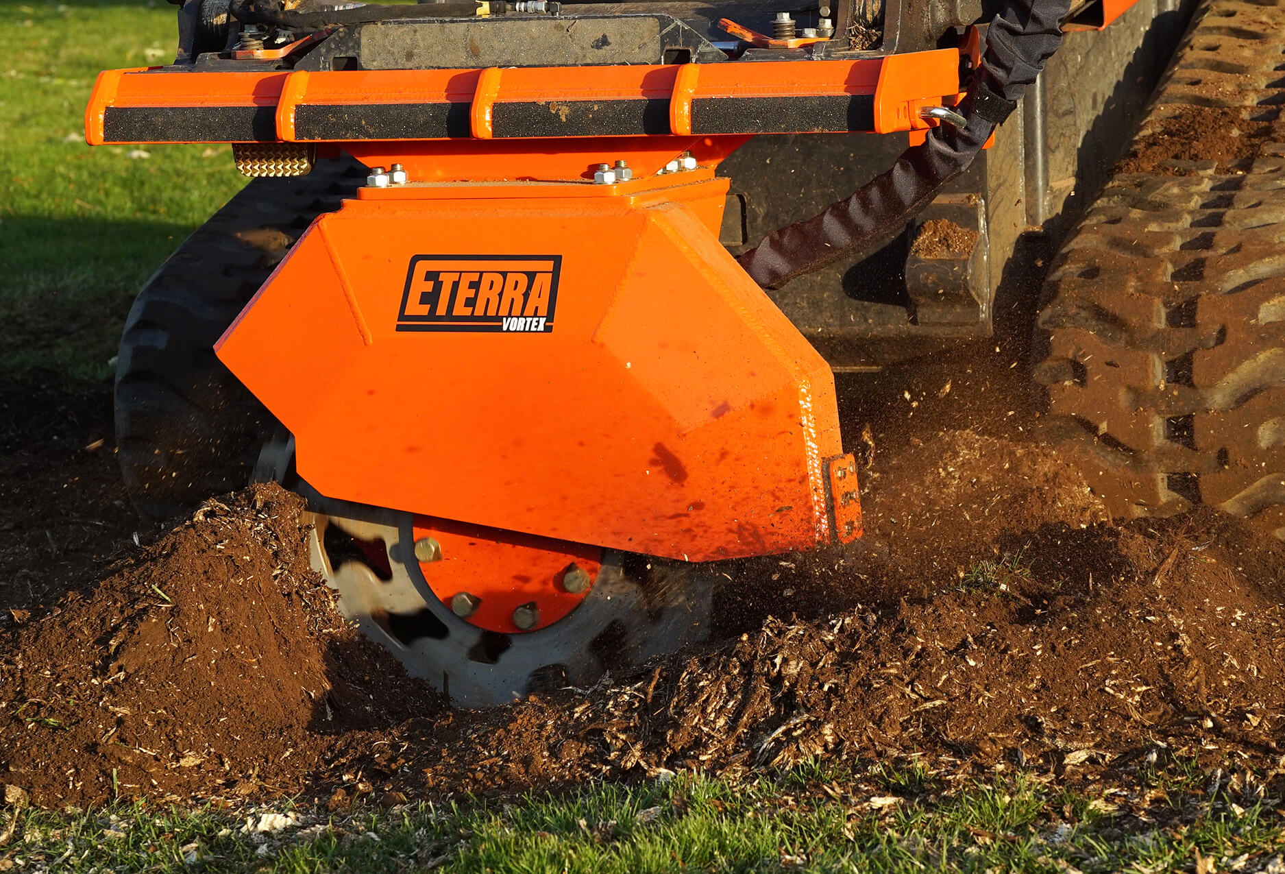 Vortex skid steer stump grinder action