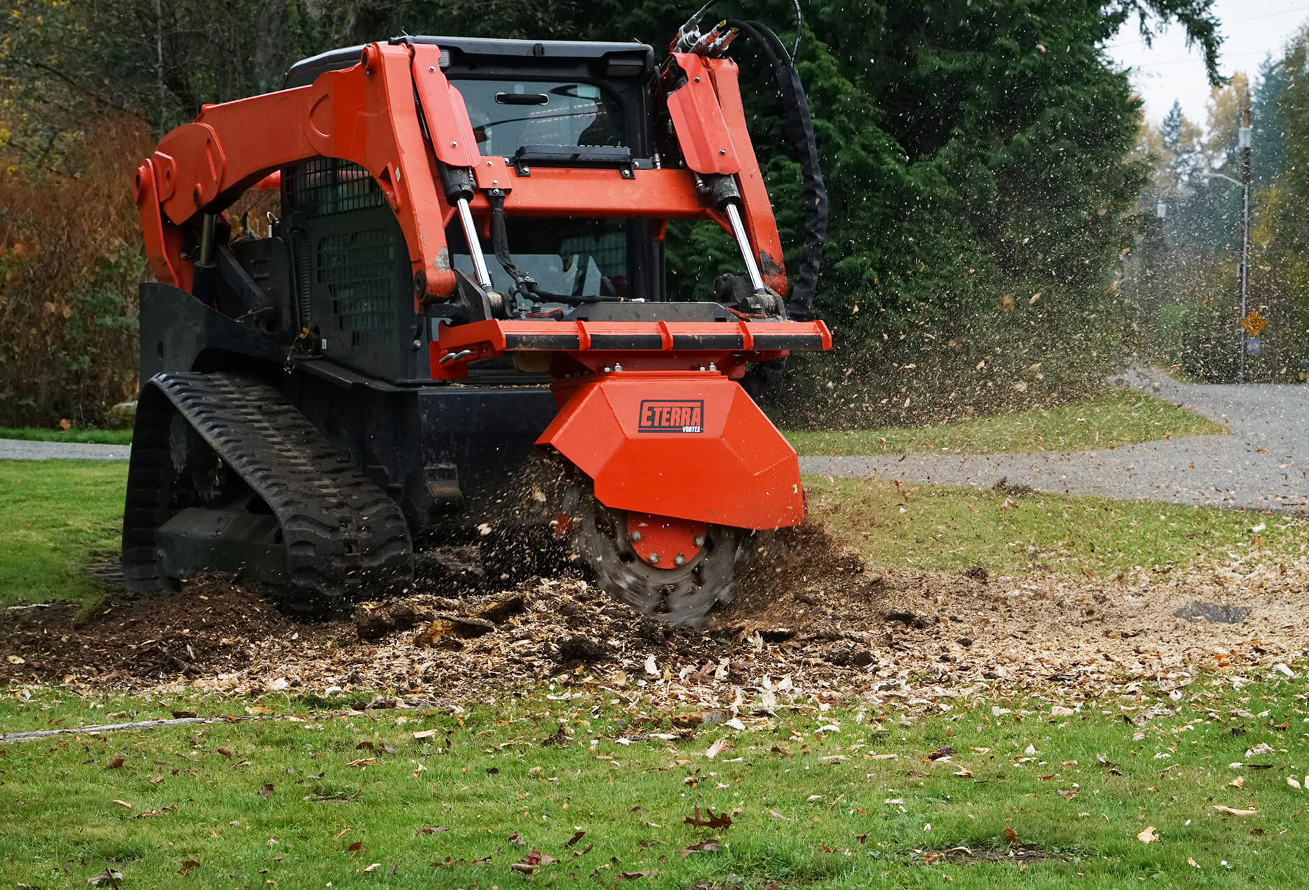 Skid Steer Stump Grinder action grinding stump