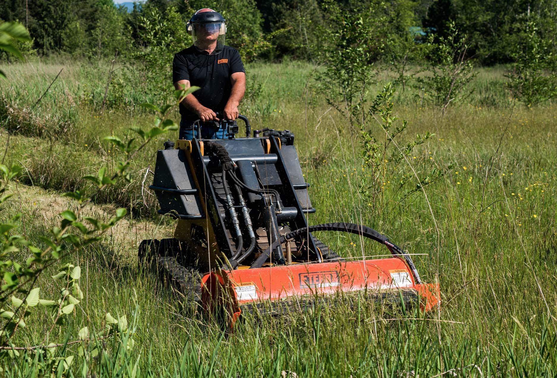 Eterra Sidewinder Skid Steer flail mower on mini field mowing mowing