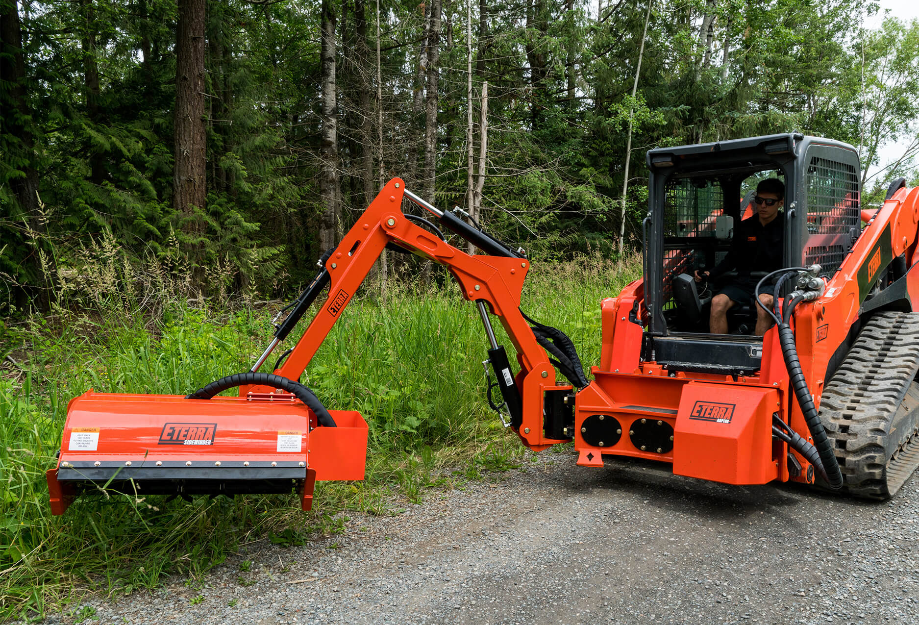 Eterra Sidewinder Skid Steer flail mower on Raptor boom arm mowing roadside