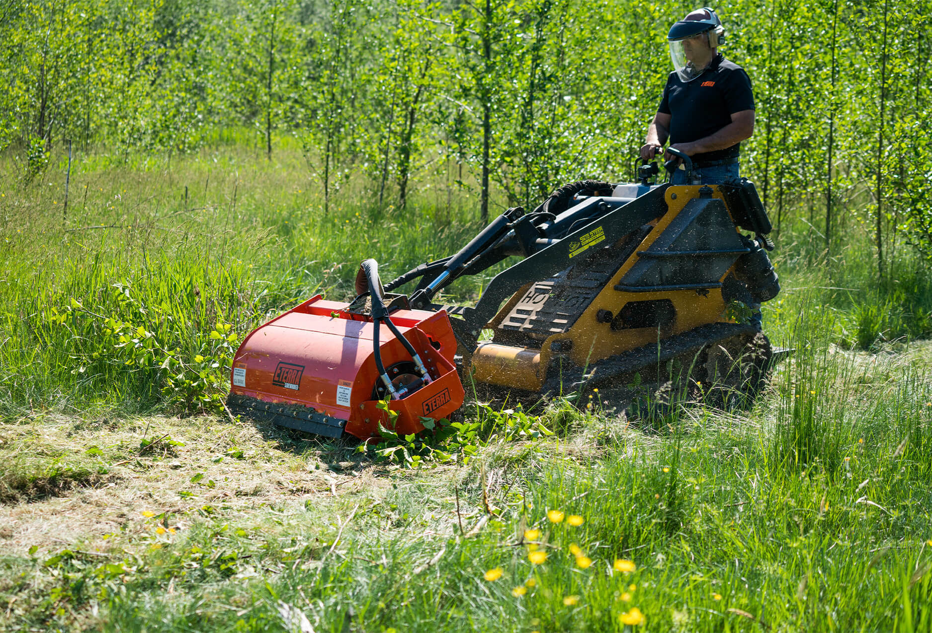 Eterra Sidewinder mini Skid Steer flail mower side angle on vermeer