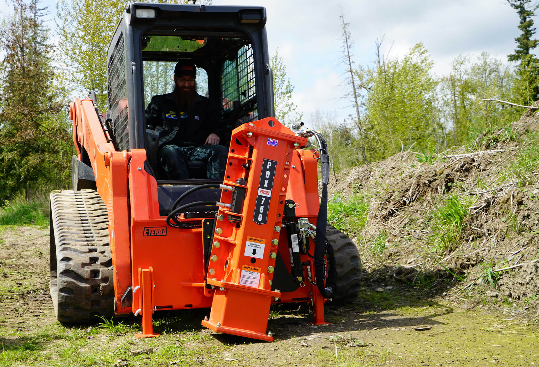 Eterra PDX-750 Post Driver Attachment action on skid steer
