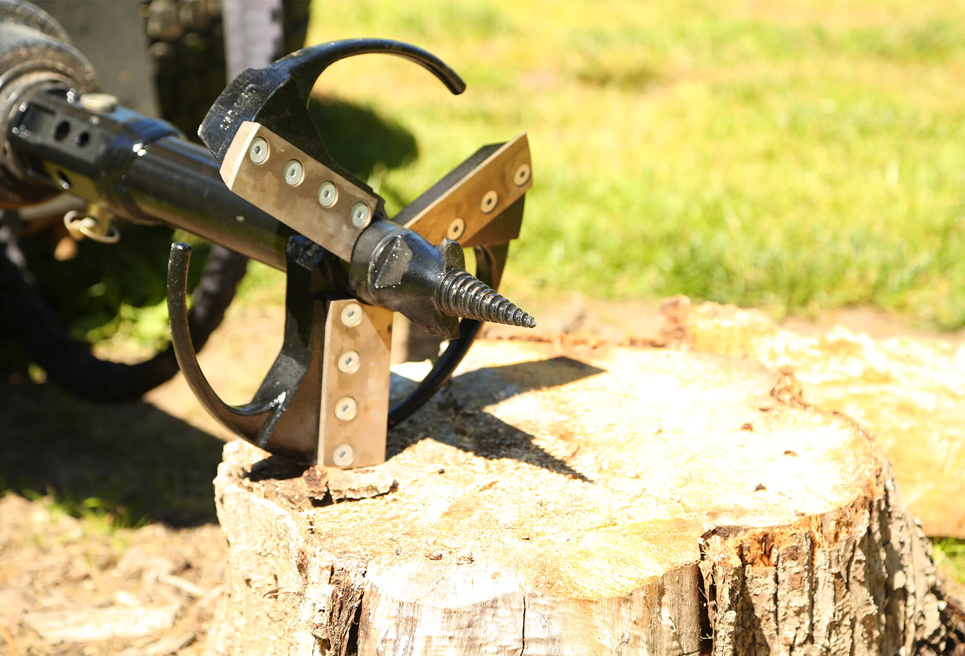 auger stump planer connect to a skid steer auger drive.