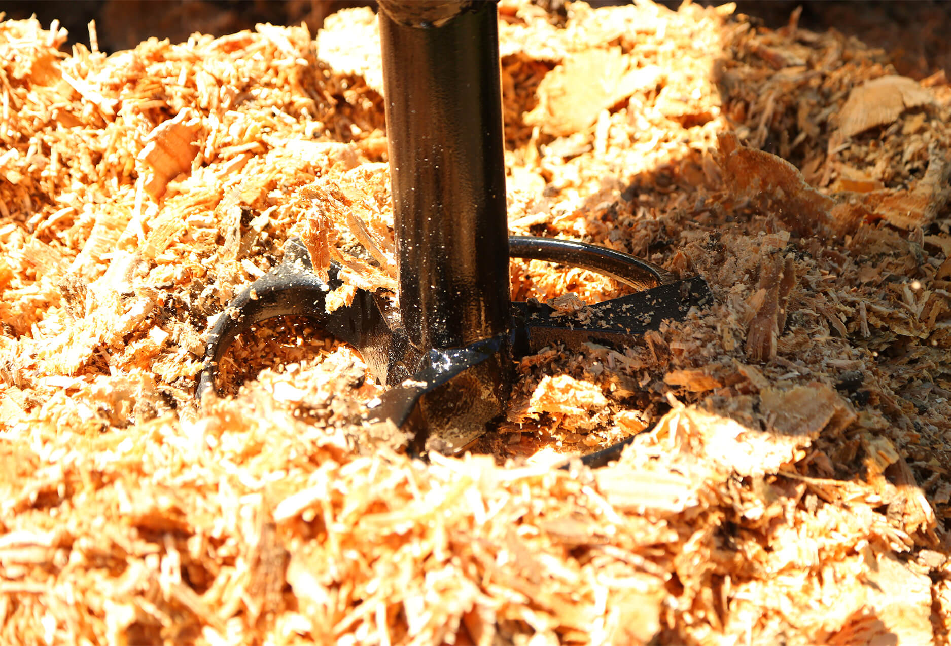 tree stump successfully removed using the skid steer auger stump planer.
