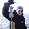 Weighing Big Fish With Electronic Hand-Held Hanging Scale