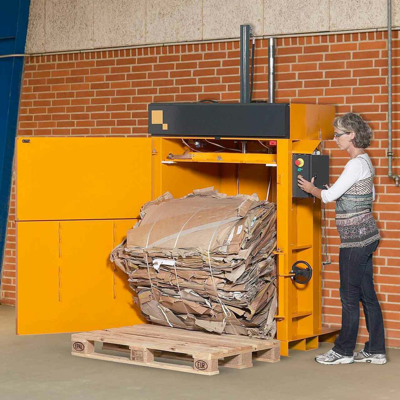 Removing cardboard bale