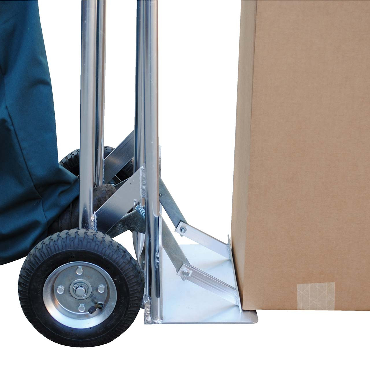 The hand truck slides the load out with a step on the back plate