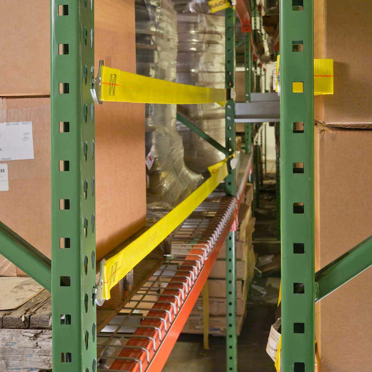 Safety straps get mounted to the back of the pallet racking