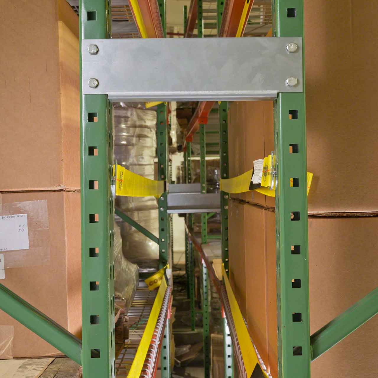 Pallet racking safety straps work well for pallet rack with spacers, protecting the hard to reach area between racks