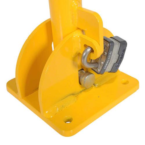 A padlock  locks the folding bollard into an upright position