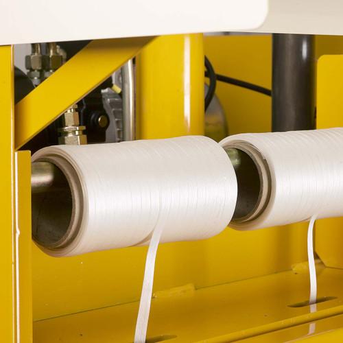 Baler strapping mounted on machine