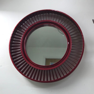 Crafted from a Pratt and Whitney JT8D engine fan blade, this wall hung mirror is a great addition to any space.  Available red, blue, green, orange, black, white and silver this piece blends aviation history with modern art and functionality.