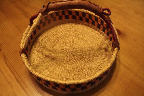 Bolga Basket.  Leather Wrapped Handle and Round Bottom