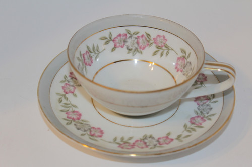 Grey and White Floral Trimmed Noritake Teacup and Saucer Set