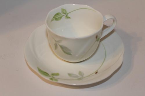 Vintage EVA Air Teacup and Saucer Set