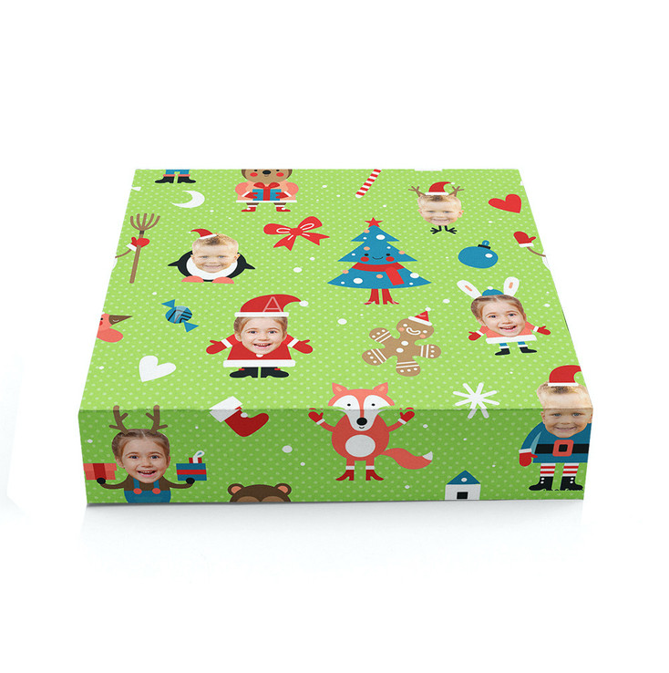 Present Wrapped in Green Christmas Wrapping with Faces