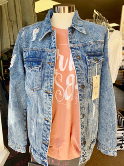 Looking for a perfect Blue jean/Denim jacket for those cool days of fall ?  We have a Distressed Jeanz jacket for you !   This denim jewel comes in a weathered denim look with distressed accents on the front and the back.  longer style, button front, double breasted front pockets, and side pockets, heavy/sturdy denim fabric.  100% cotton