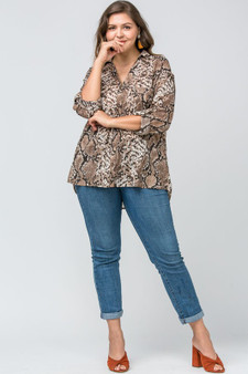 Darling, you are gonna look fabulous in this fantastically fashionable Reptile Style sheer Button up shirt.  Plus size button up blouse, in beautiful reptile print,  long sleeve   Reptile print button-up top featuring pockets at bust. Button closure detail at sleeve. Semi-sheer. Woven. Lightweight. 100%Polyester