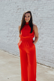 "Red - Halter Mock neck jumpsuit total lenght fron hips 59"" inseam 30"" Model is wearing a small."